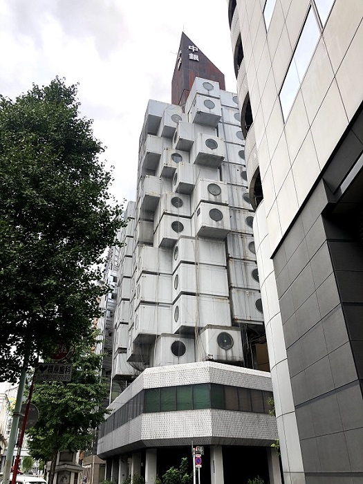 「中銀」と書かれた茶色い塔がコア、ぶどうの枝葉のようにカプセルがついています(C)コクハク